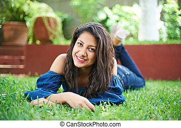 teenager laying on grass