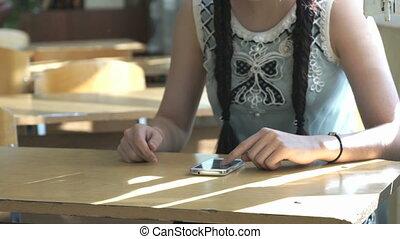 Teenager looking information using mobile phone