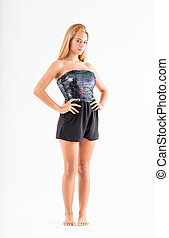 teenager model with her arms akimbo on a white background with a challenging sly and smart expression