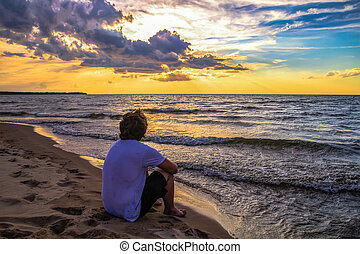 Teenager On Beach At Sunset