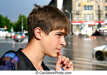 teenager on the street - The teenager on road with heavy ...