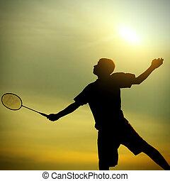 Teenager playing Badminton - Silhouette of Badminton Player...