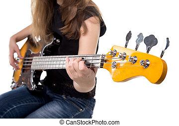 Teenager playing on guitar