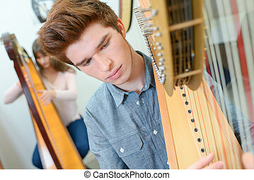 Teenager playing the harp