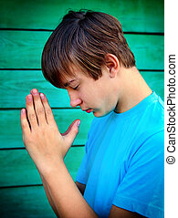 Teenager praying outdoor