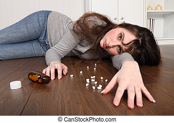 Teenager prescription drug overdose on floor