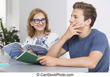 Male teenager during private lesson with female tutor