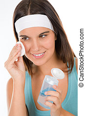 Teenager problem skin care - woman cleanse with cotton pad