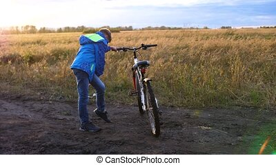 Teenager riding a bike, doing sports in the fresh air....