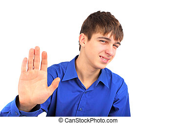 "teenager say no - The teenager shows ""no"" gesture"