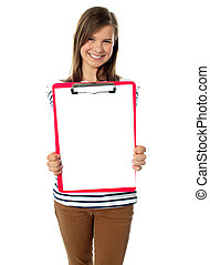 Teenager showing blank paper on clipboard