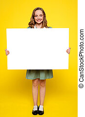 Teenager showing white blank billboard