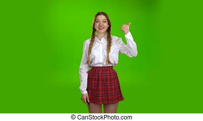 Teenager shows a thumbs up . Green Screen