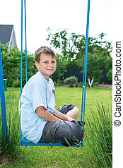 teenager sitting on a swing