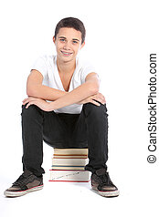Teenager sitting on pile of books
