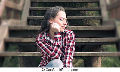 Teenager sitting on the stairs and enjoying life