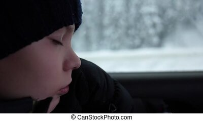 Teenager sleeping in the car in slow motion. Face close-up