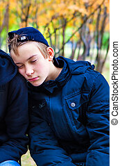 Teenager sleeping outdoor