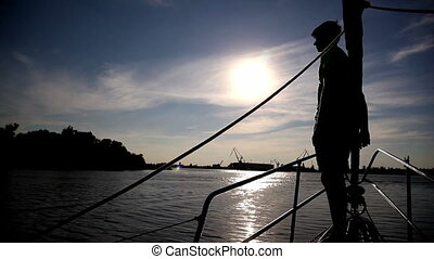 teenager standing on the bow of the yacht
