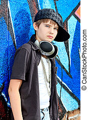 teenager - Portrait of a trendy boy teenager with headphones...