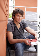 Teenager student - handsome teenager next to a red brick...