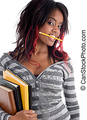 student holding her study book - teenager student holding...