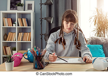 Teenager studying from home