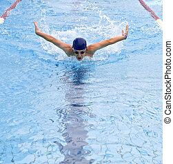teenager swimmer in a butterfly stroke
