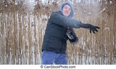 Teenager throw snowballs