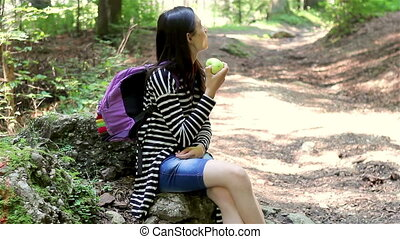 Teenager tourist girl eating apple