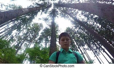 Teenager walking on forest selfie s