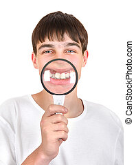 Teenager with a Loupe - Teenager holds a Loupe in front of...