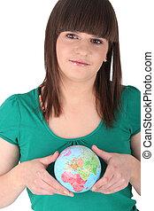 Teenager with a mini globe