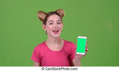Teenager with a phone and paper notes in his hands. Green screen
