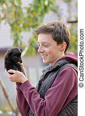 Teenager with a small puppy