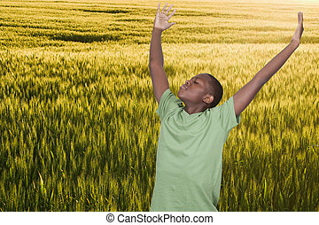 Handsome young African American teenager with allergies in a field