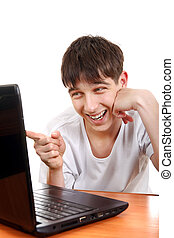 Teenager with Laptop - Doubtful Teenager showing the Finger...