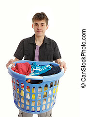 Teenager with laundry basket - Teenager holding a blue...