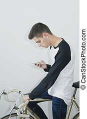 teenager with the mobile phone on bicycle vintage white background