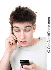 teenager with two phones