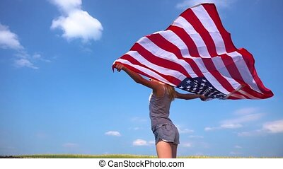 Teenager with USA flag in nature - Side view of young...