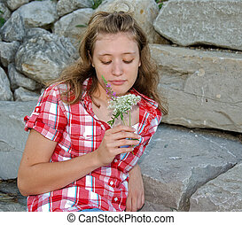 teenager with wildflowers