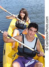 Teenagers canoeing