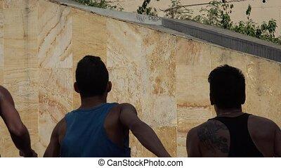 Teenagers Climbing A Wall