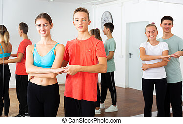 Teenagers dancing in pairs in choreography class - Teenagers...