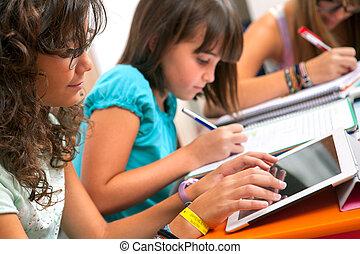 Teenagers doing schoolwork. - Close up of Teenage girls ...