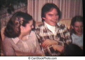 Teenagers Enjoy Christmas Tree 1980 - Three sibling teenager...