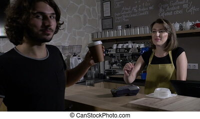 Teenagers female and male customers paying with crypto...
