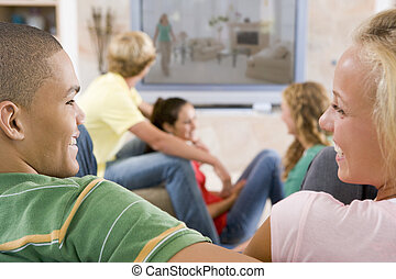 Teenagers Hanging Out In Front Of Television
