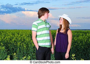 Teenagers in Canola Field